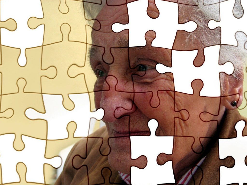 man's face superimposed on puzzle with pieces missing