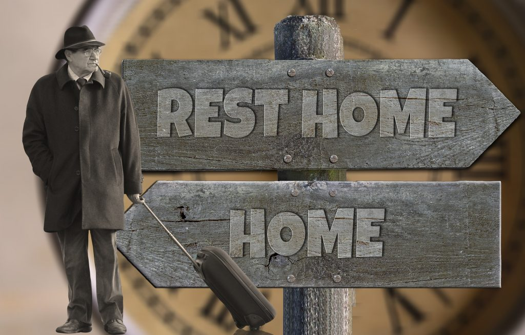 sign pointing to rest home and home