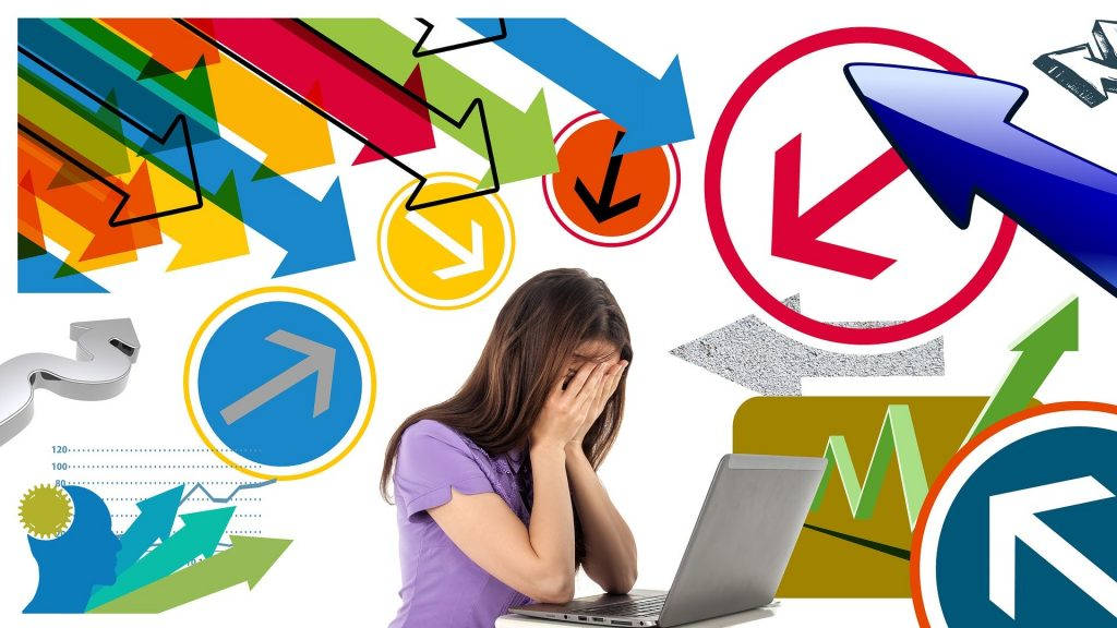 young women in front of computer feeling overwhelmed