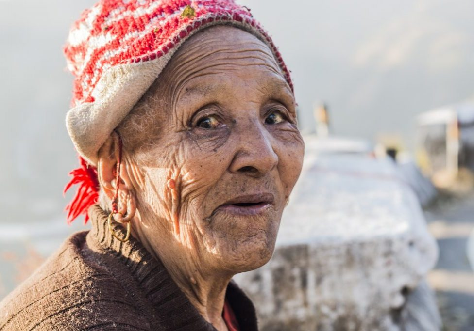 older woman wearing a hat